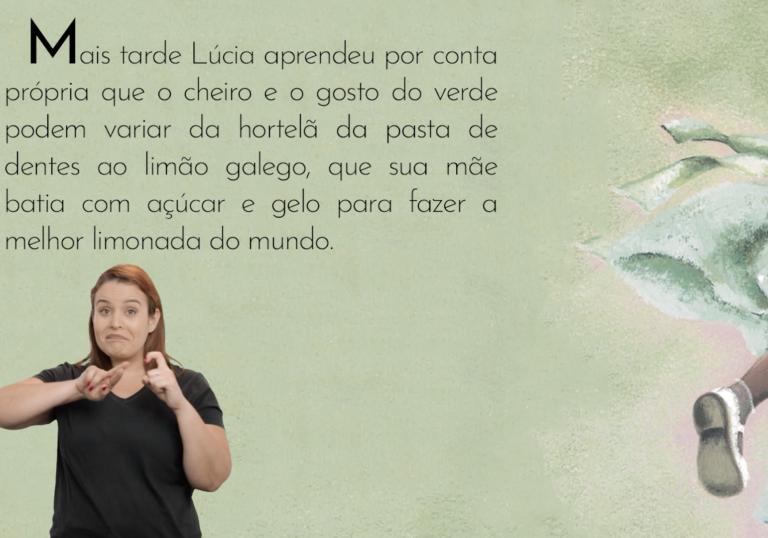 A imagem mostra uma cena do livro audiovisual acessível na qual aparecem um trecho da história e a intérprete de Libras. Há também uma ilustração com a perna de uma menina negra e uma parte da saia. A menina calça um sapato branco.